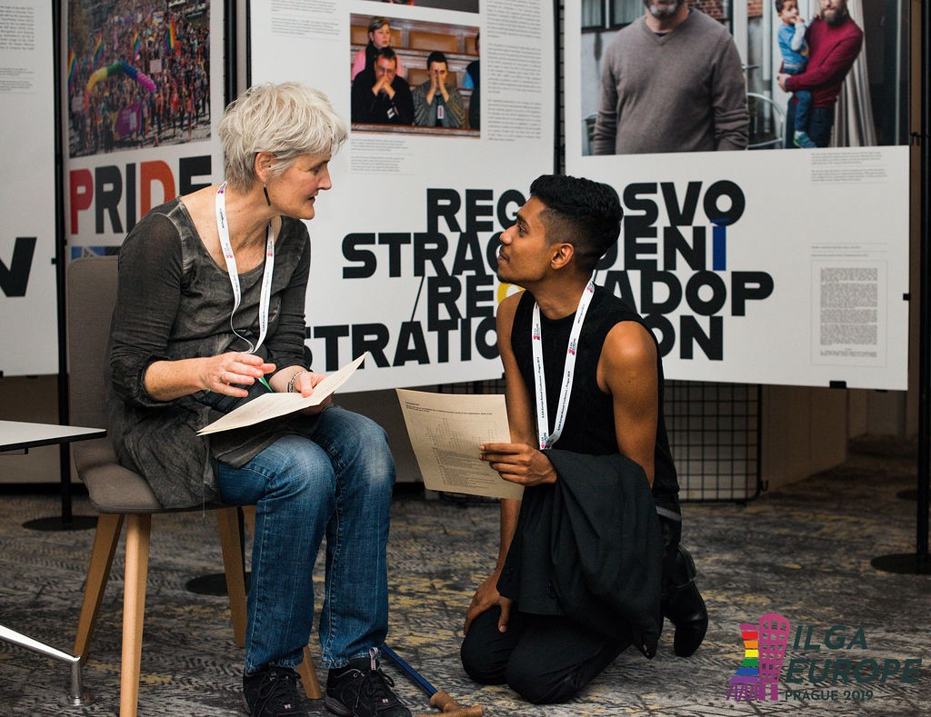 Two participants from differing generations engage in conversation
