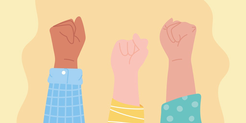 Simplistic illustration of three fists with various skin tones held aloft against a yellow background.
