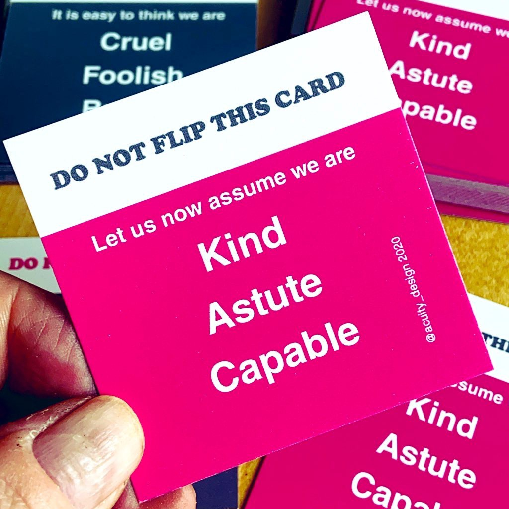 Square card held up — text says Do not flip this card. Let us now assume we are kind, astute and capable