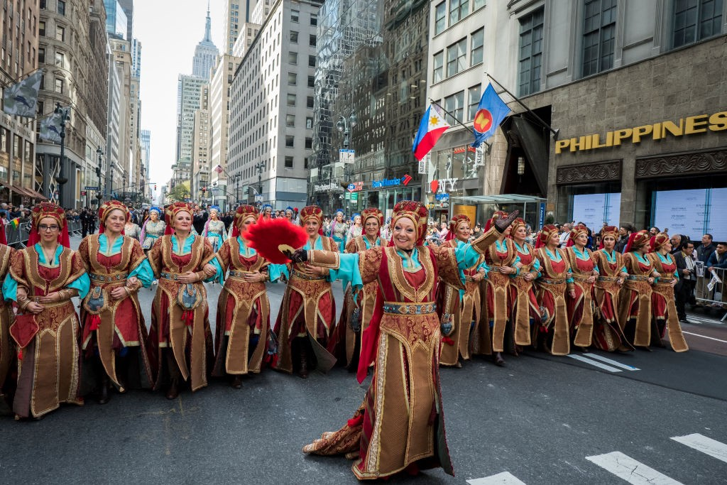 Dancers wearing Spanish costumes marching down 5th Avenue in New York for Hispanic Heritage Month.
