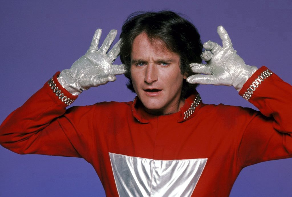 """Comedian Robin Williams in his red and silver """"Mork"""" costume"""