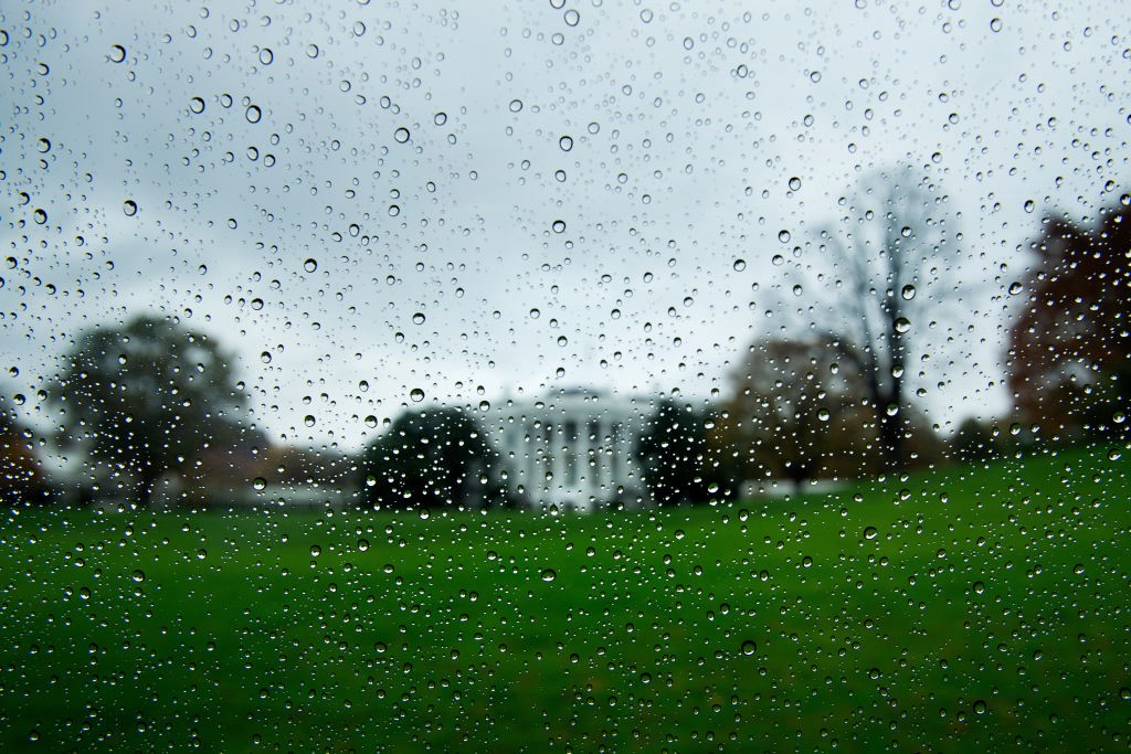 Blurry rain-specked view of the White House on a gloomy day.
