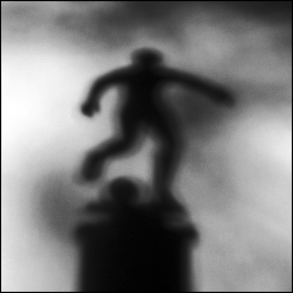blurry shadow of a person on a trophy