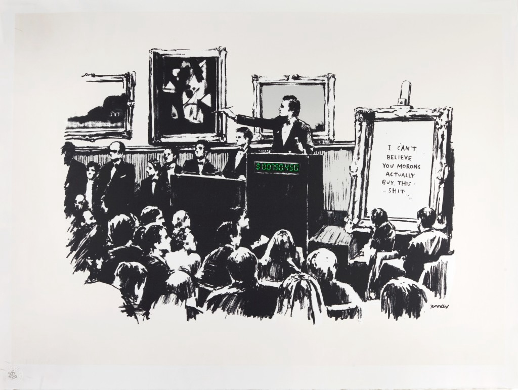 """Banksy's monochromatic print, described above, depicting an illustration of a packed art auction house. The auctioneer is pointing to a bidder and the framed canvas in the foreground says, """"I can't believe you morons actually but this shit."""""""