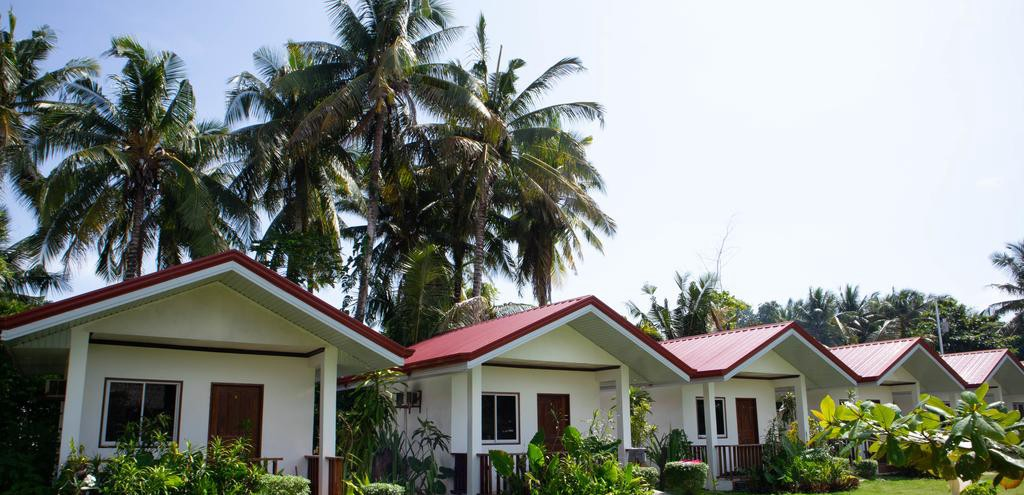 A row of tropical bungalows.
