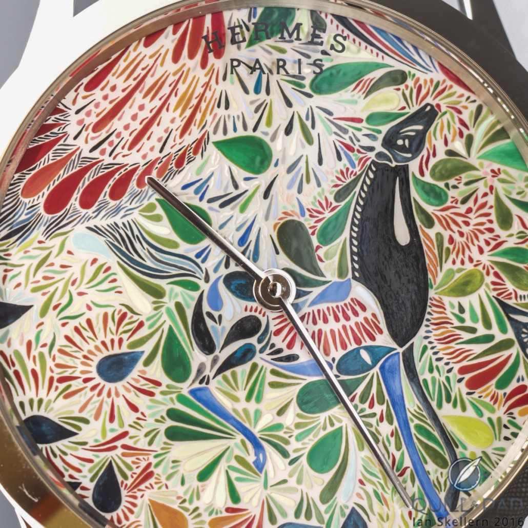 A close look at the miniature painting on mother-of-pearl dial of the Slim d'Hermès Mille Fleurs du Mexique