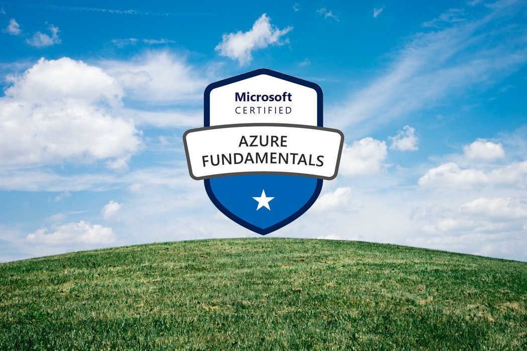 "Shield logo that reads ""Microsoft Certified Azure Fundamentals"" on a blue sky background with a green, grassy hill."