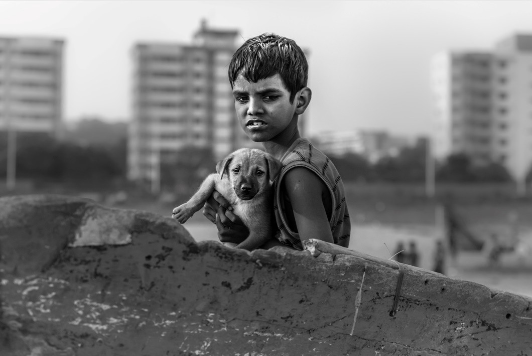 A Young Boy And His Dog—Photo by Patrick Hendry on Unsplash