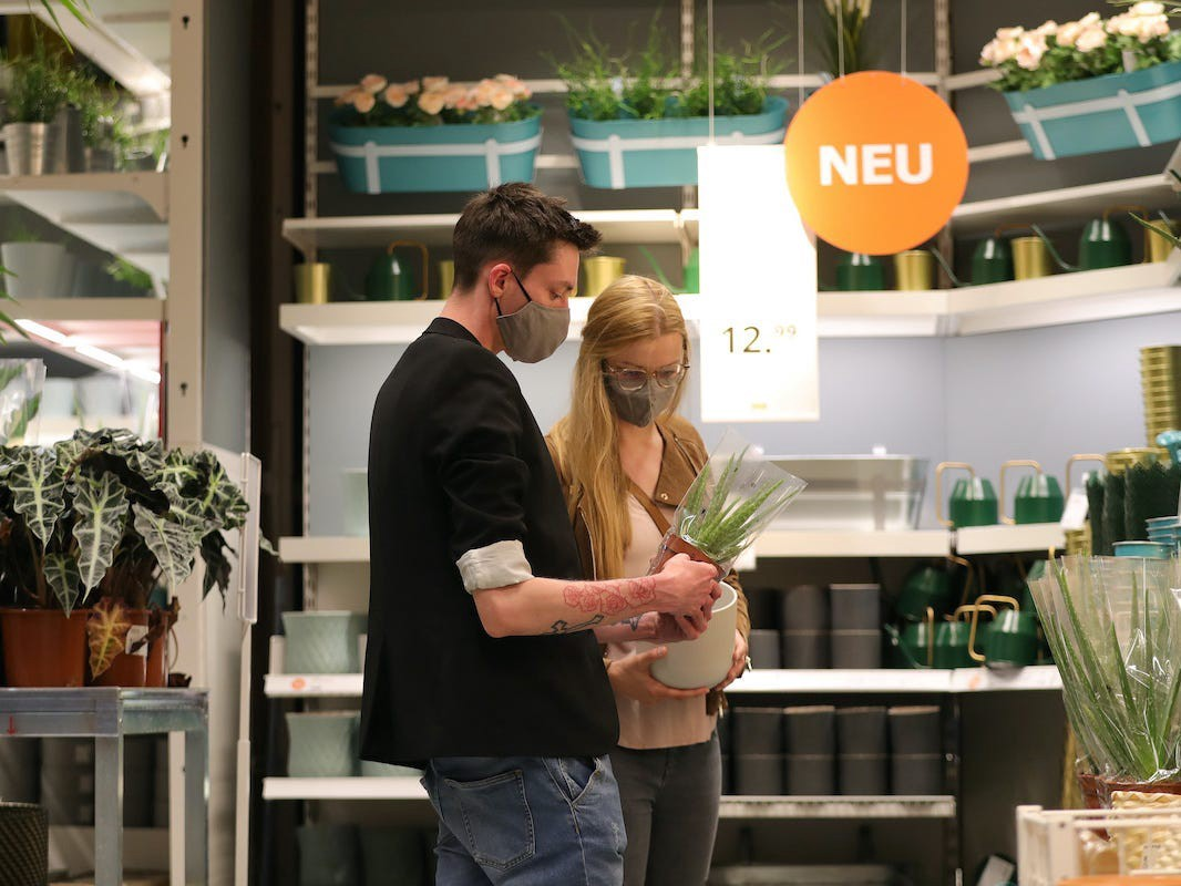 Two people shop for plants at Ikea.