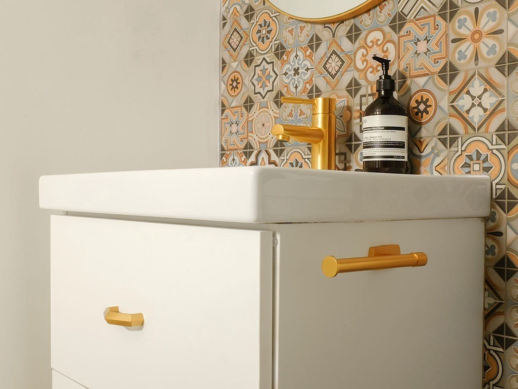 An Ikea vanity with gold hardware.