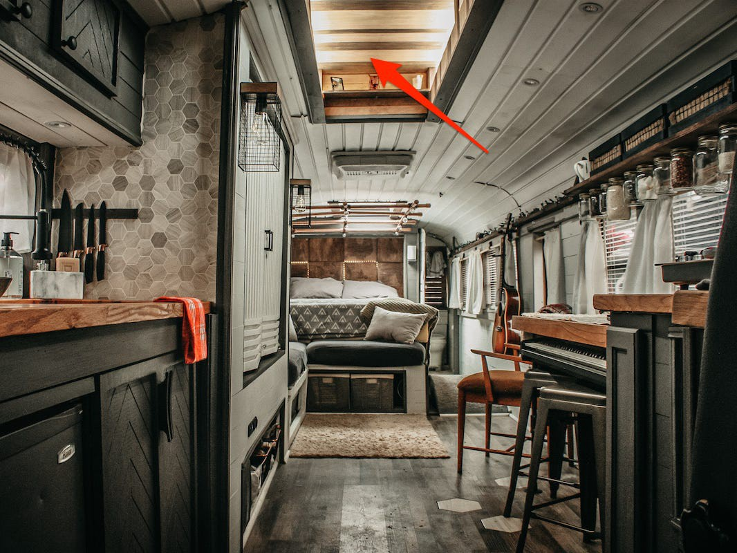 An arrow points to the skylight Brackney installed in his 1995 retired school bus.