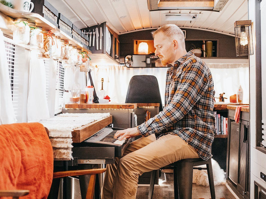 The bus owner playing piano