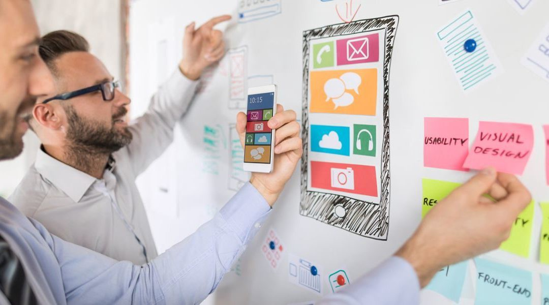 Two designers examining elements of an app