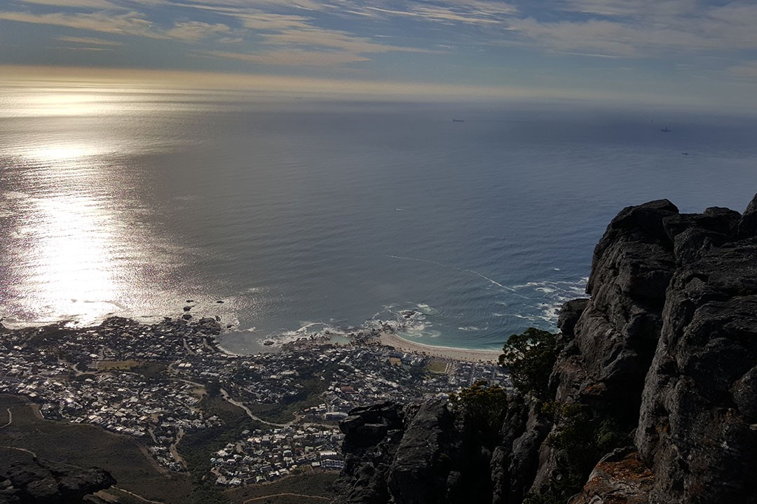 An aerial view over Camps Bay from the top of Table Mountain