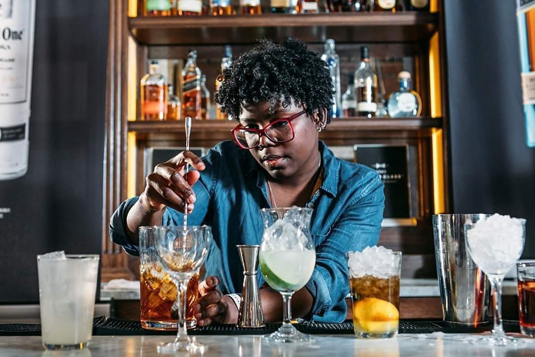 A bartender mixing drinks.