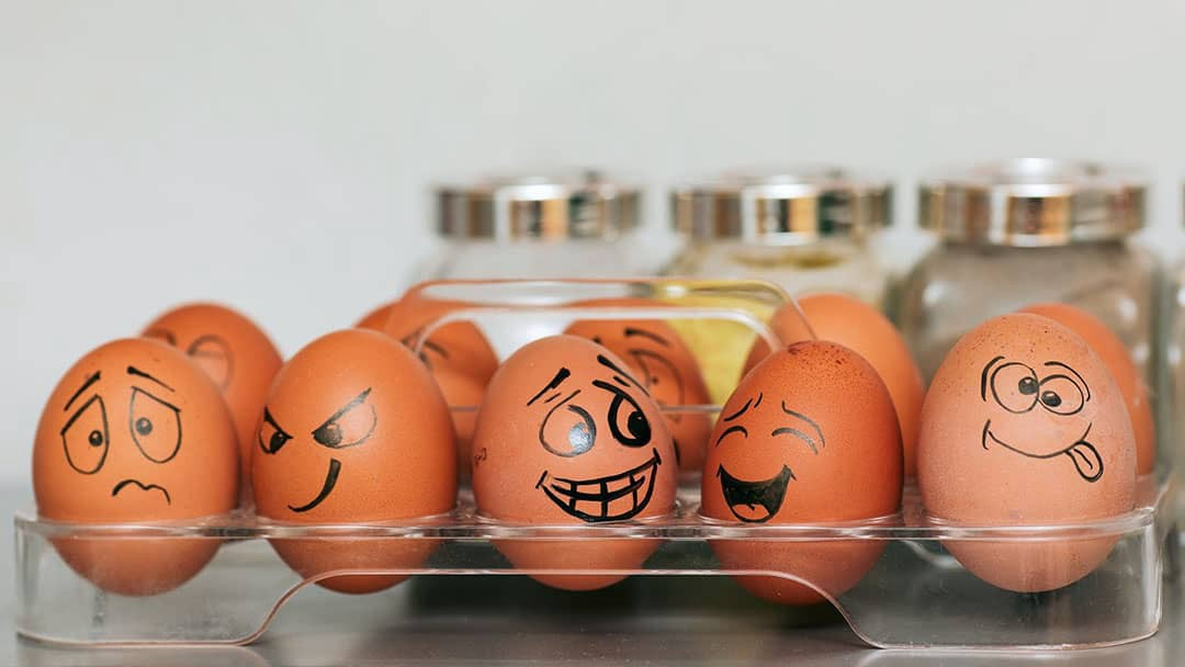 Egg with emotional faces drawn on them