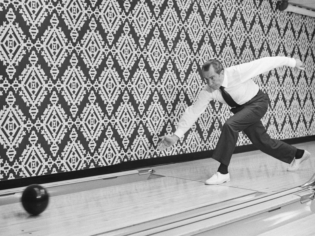 President Nixon is the picture of concentration as he releases bowling ball at Executive Office Building lanes.