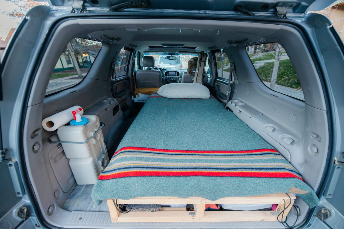 The bed is located in the back.