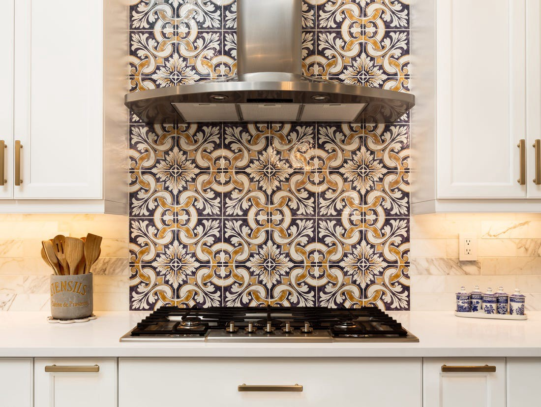 Interesting, handcrafted designs are becoming popular for kitchen tiles.