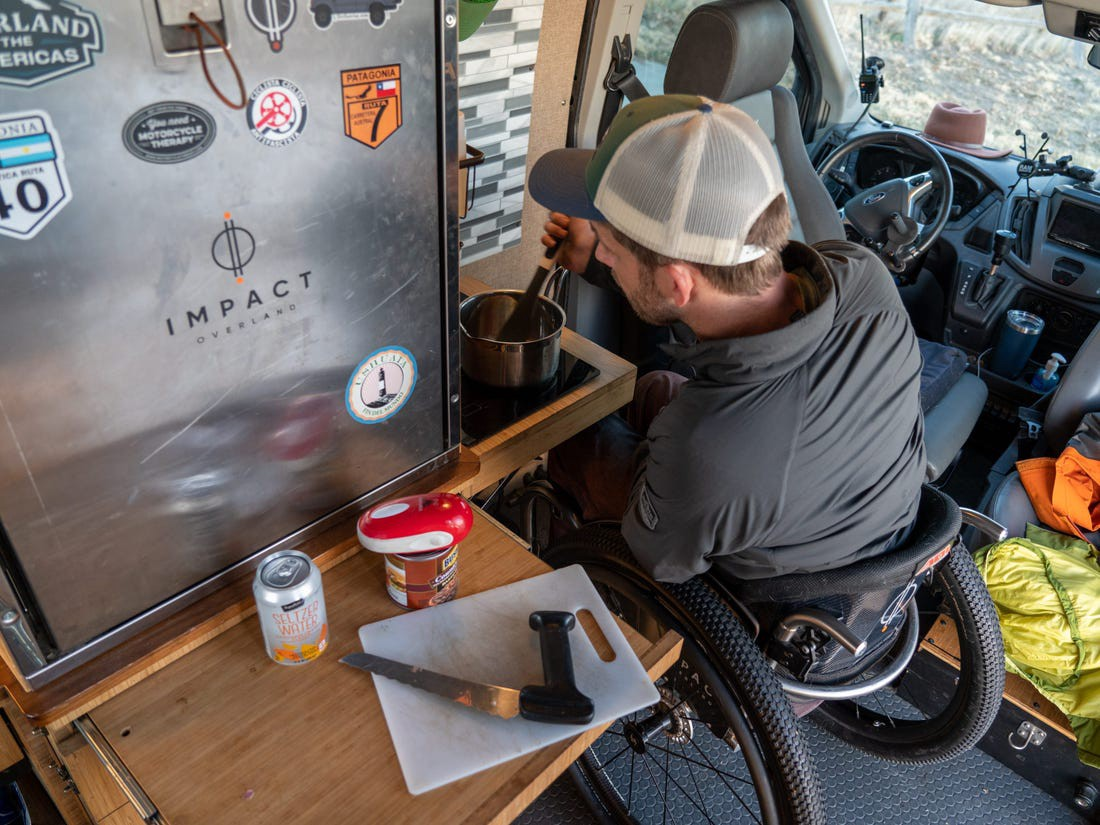Kirk Williams cooks on the induction stove inside his van.