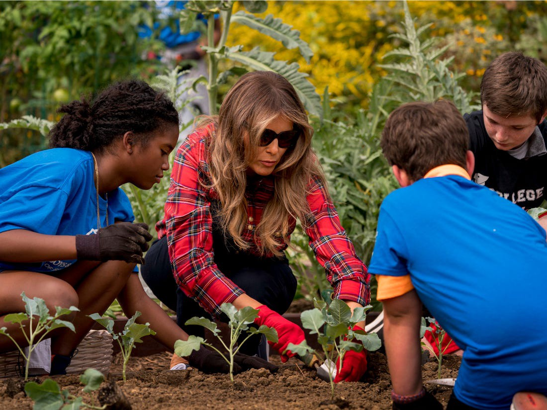 First lady Melania Trump participates in a planting event with the Boys and Girls Club of Washington at the White House.