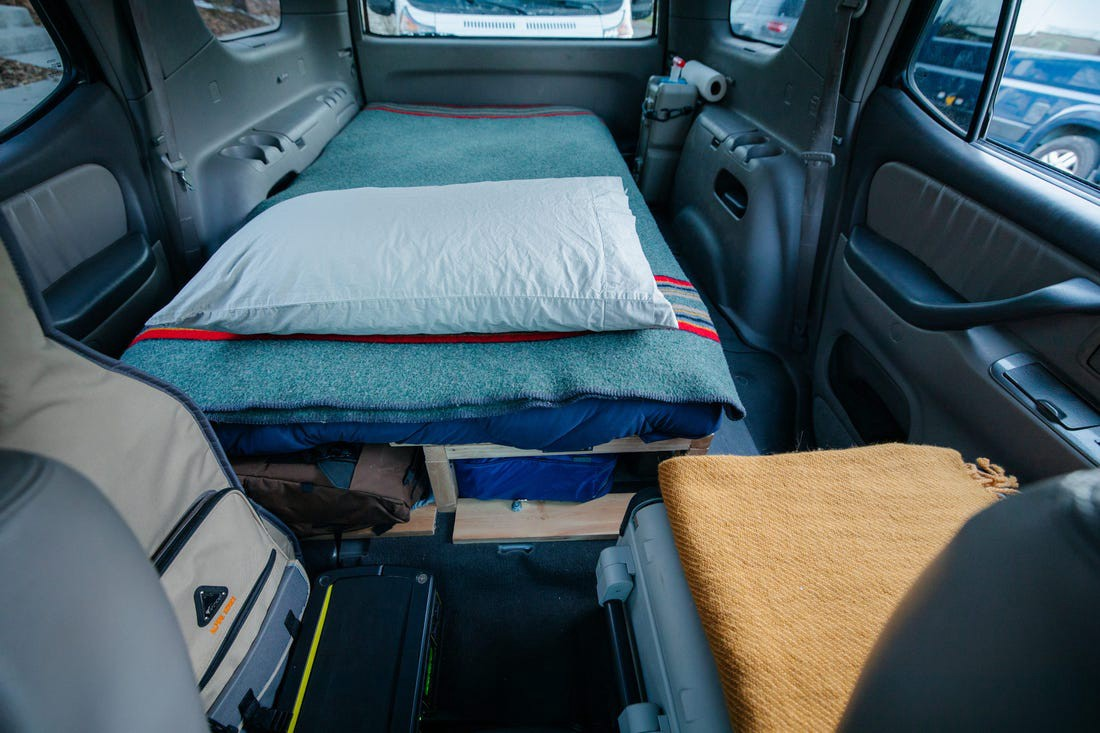 The bed in the back of the car.