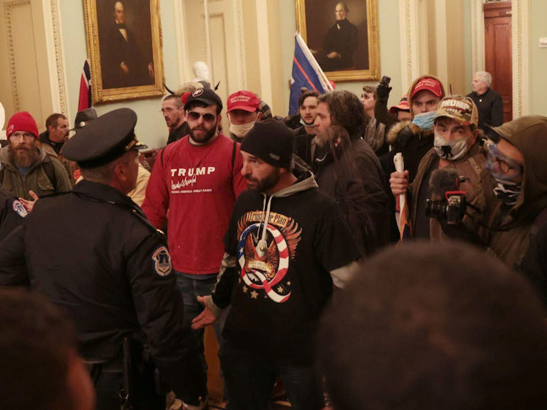 Protesters interact with Capitol Police inside the U.S. Capitol Building on January 06, 2021 in Washington, DC.