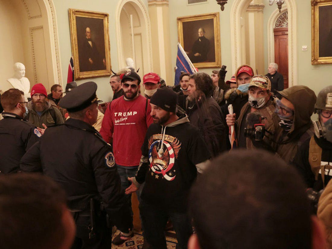 Protesters and Capitol Police officers inside the US Capitol on January 6.