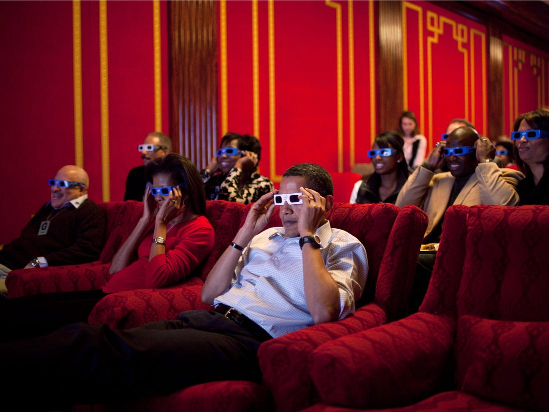 The Obamas watch a movie.