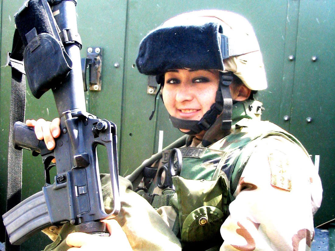 Michelle Dallocchio is pictured during her time in the military.