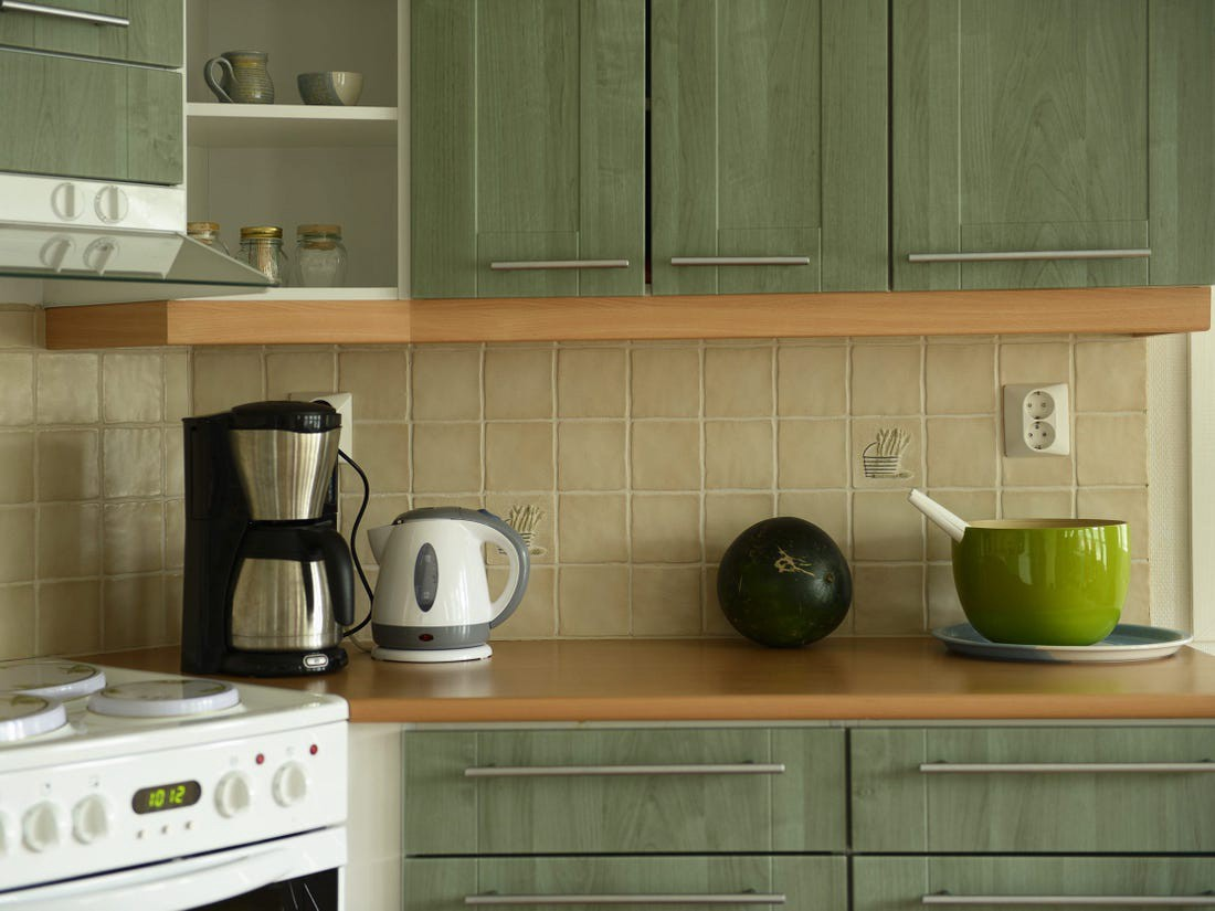 Some green cabinets can be both neutral and versatile.
