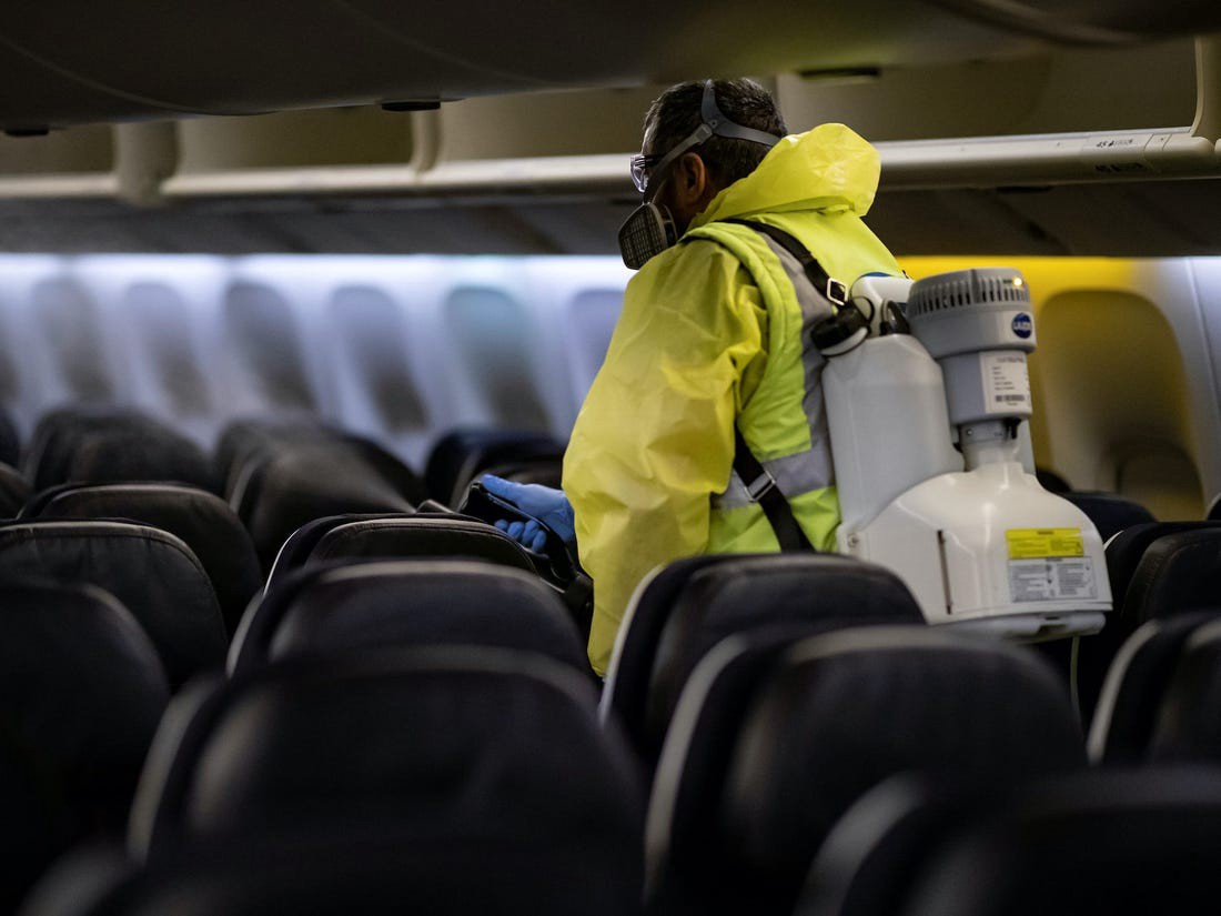 Airport staff disinfects an airplane.