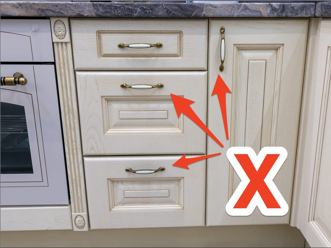 Many people are removing handles and knobs from their cabinets.