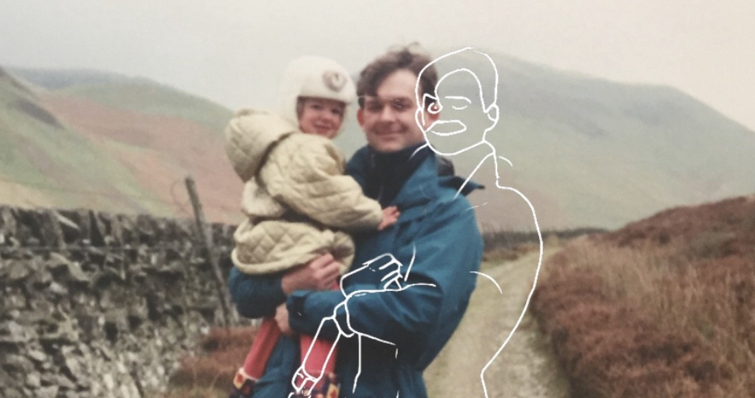The author held as a toddler by her father, while on a hike.