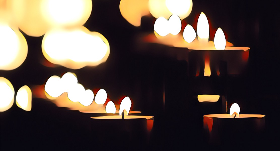 Stylized image of multiple candles with light flares