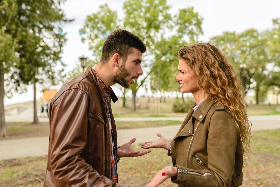 A man and woman stand in a park and seem to be upset with each other. #fight #argument #park #relationships #conflict