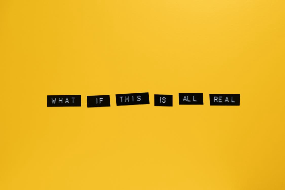 "Label maker type stickers with the wording ""what if this is all real?"" printed."