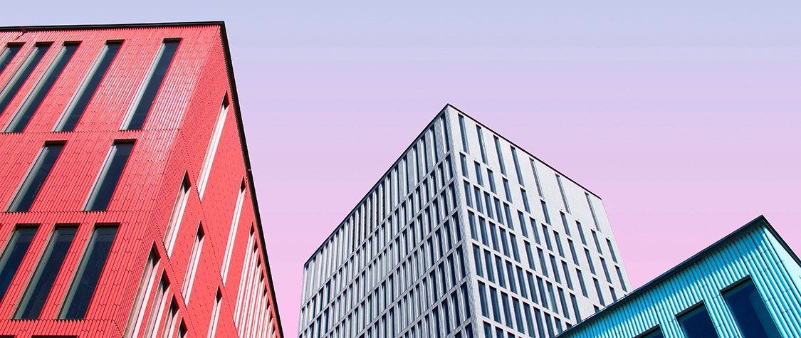 Colorful photo looking up at tall buildings.