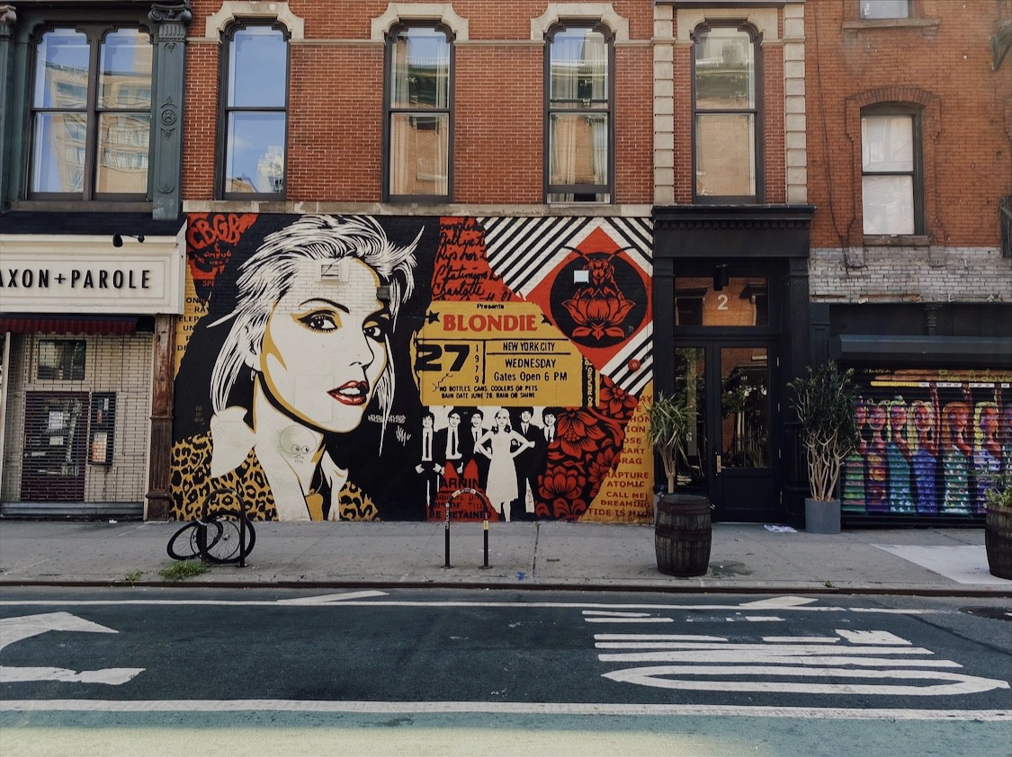 Facade of a building that has a Blondie mural in honor of Debbie Harry, located near Bowery, New York City.