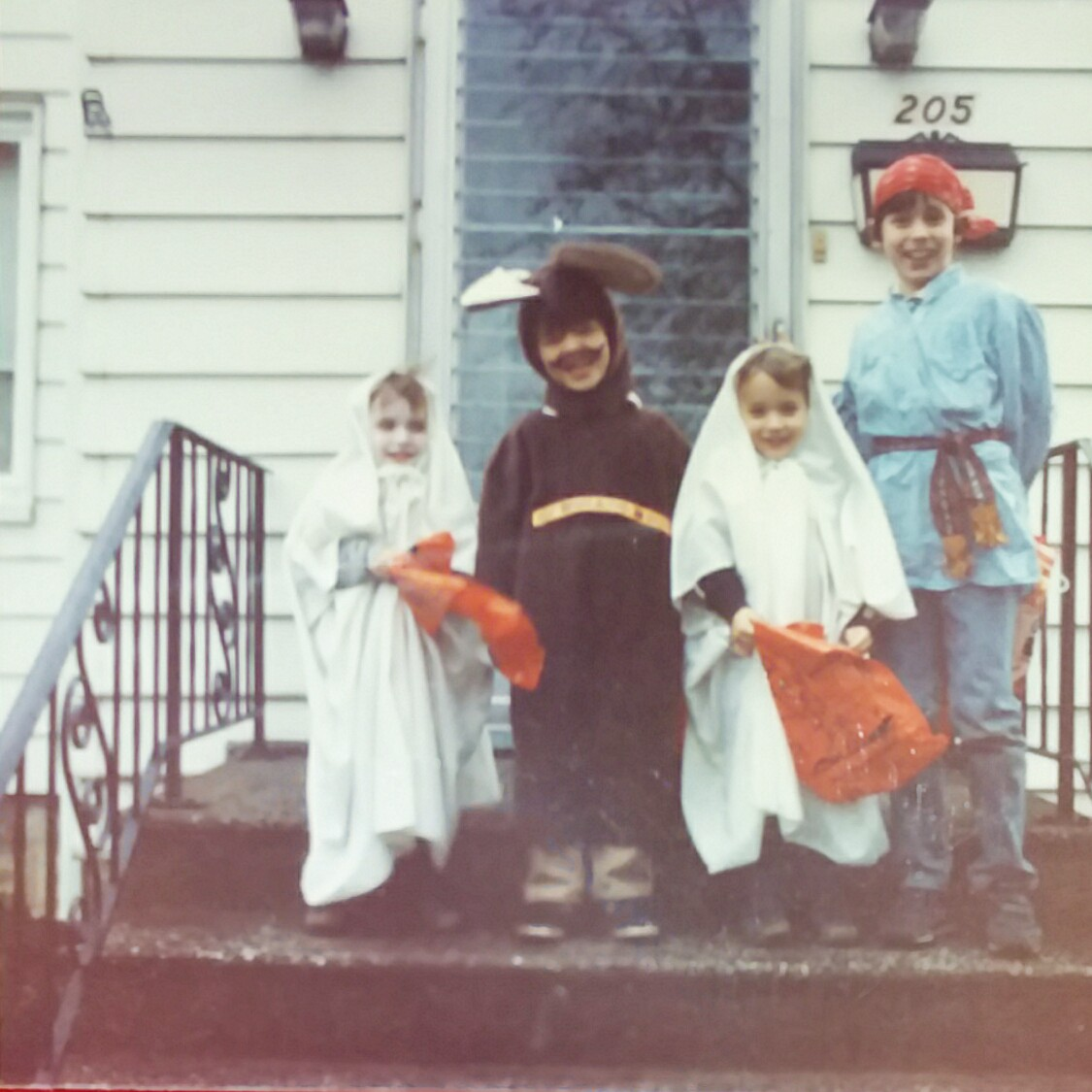 4 Children dressed up for Halloween in the 1980s
