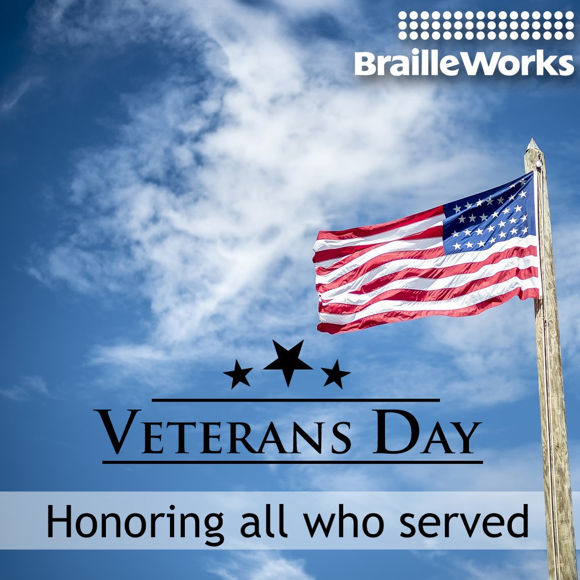 """American flag on a wooden pole waving in a lightly clouded sky with the words """"Veterans Day Honoring all who served"""" and logo"""