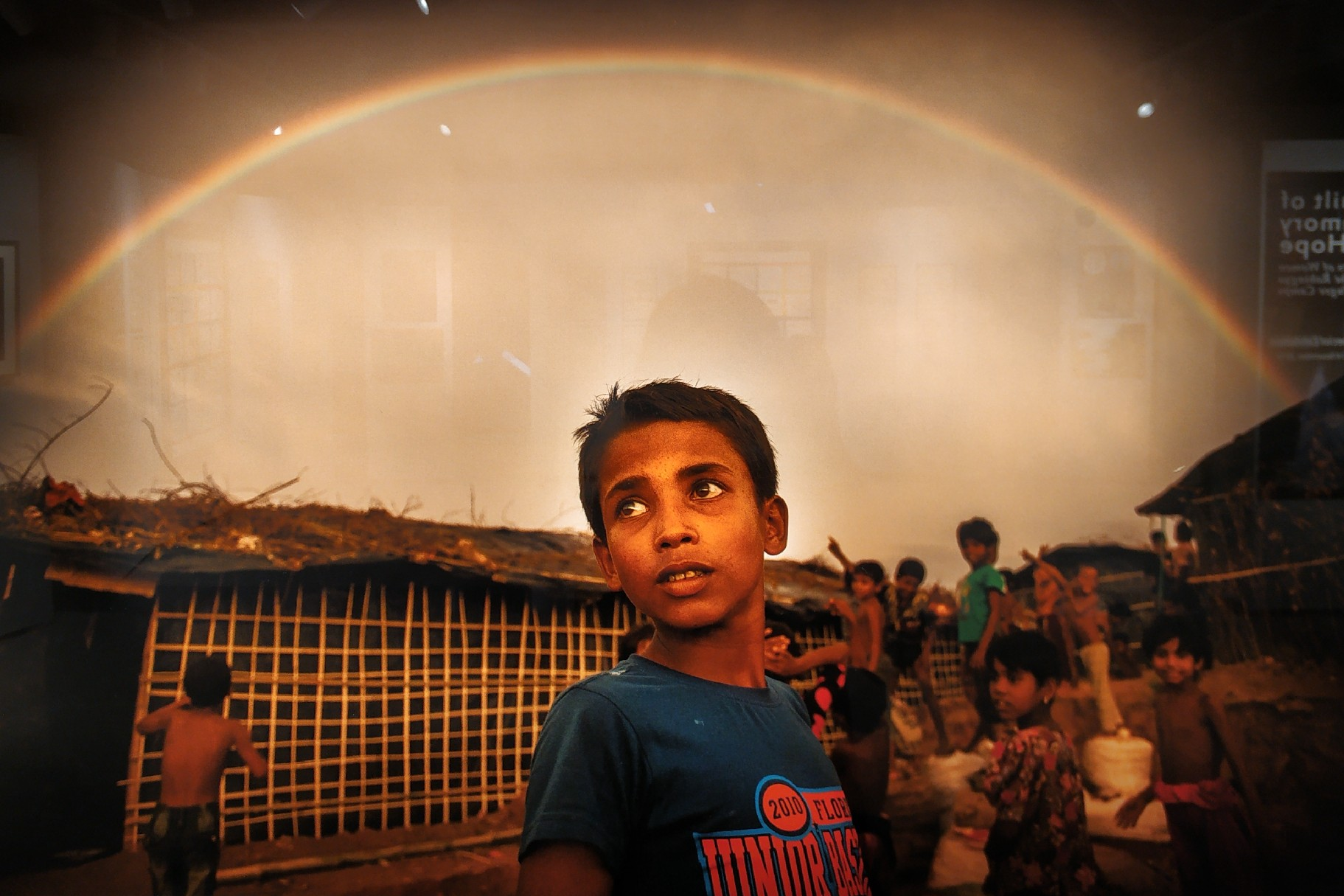 Picture of a young boy under a rainbow at Cox's Bazar refugee camps