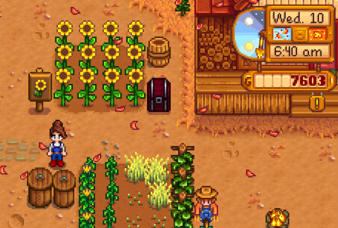 A small 8 bit farmer wearing blue overalls faces the viewer. She is beside a field of sunflowers and a barn.