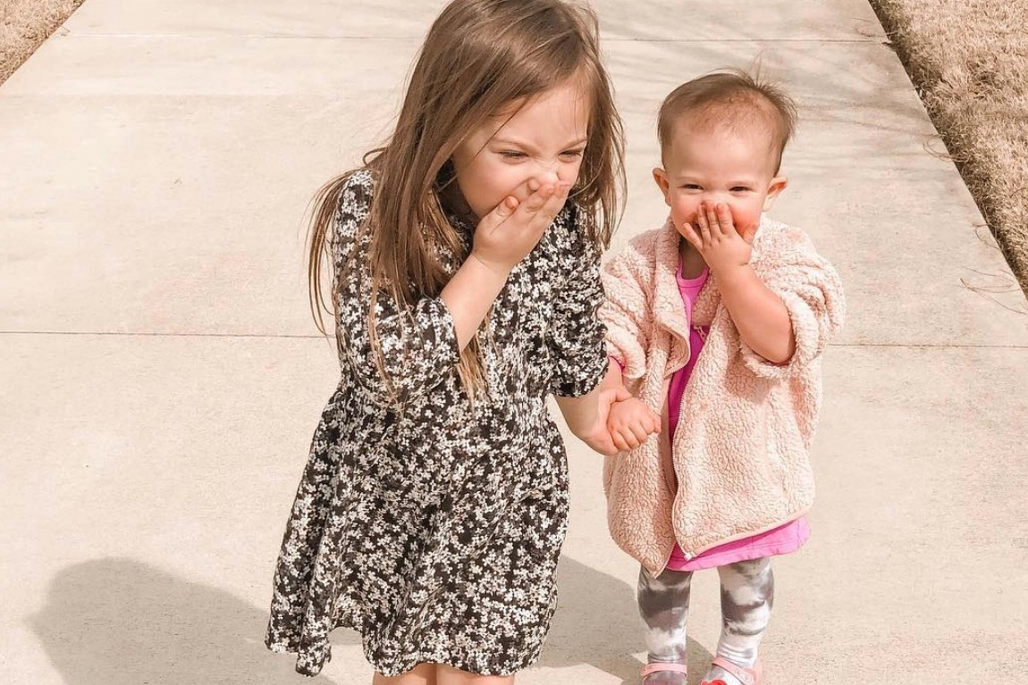 Two sisters giggling.