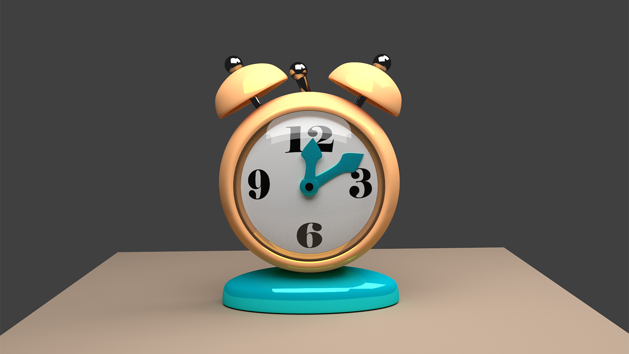 Yellow and green alarm clock on a desk