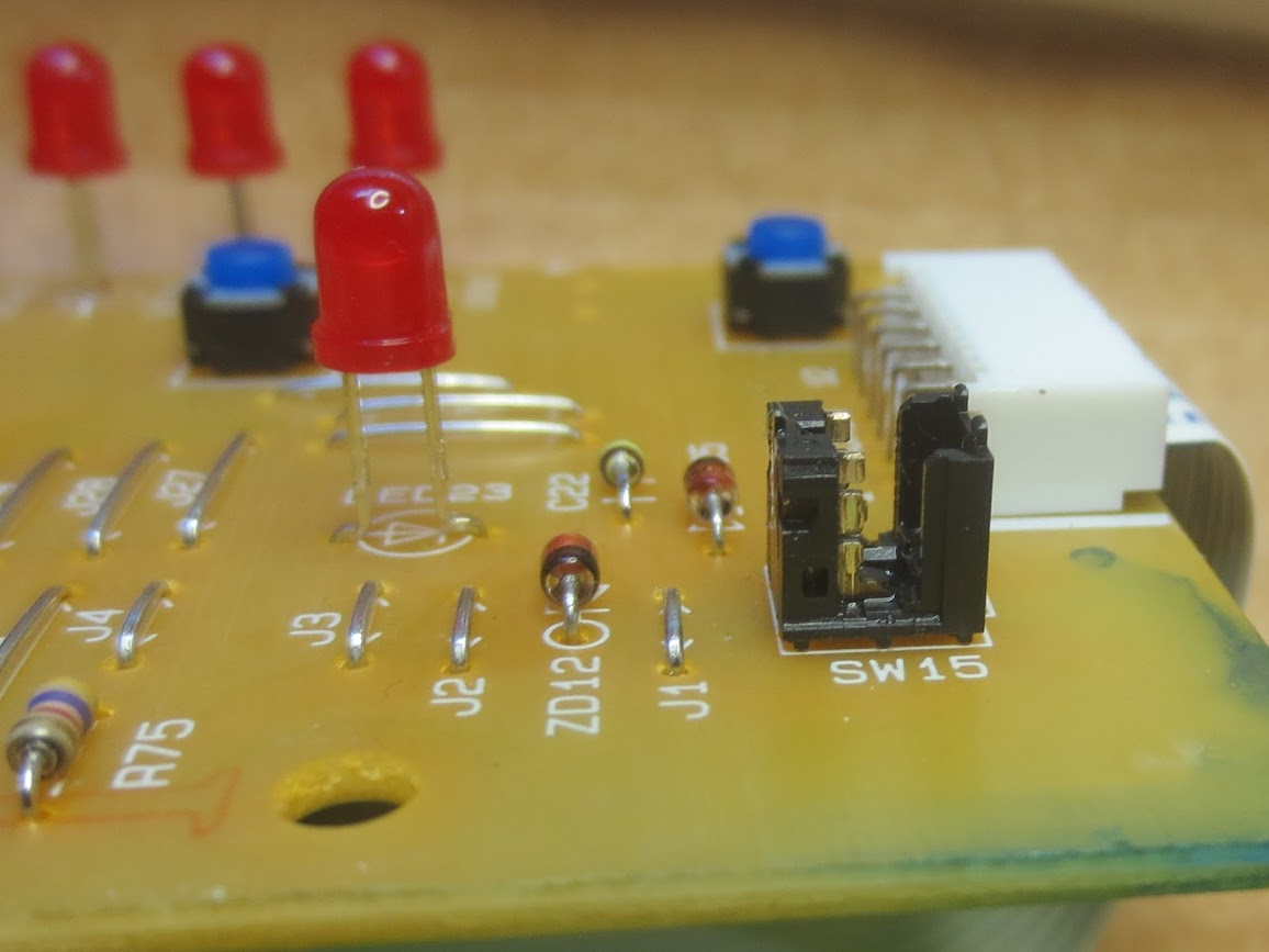 The toaster oven's circuit board after Peter soldered on the new switch. Image from Peter Mui