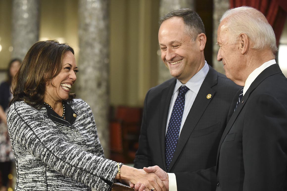 Joe Biden Congratulates Kamala Harris on his selection of her for running mate, while her husband Doug looks on.