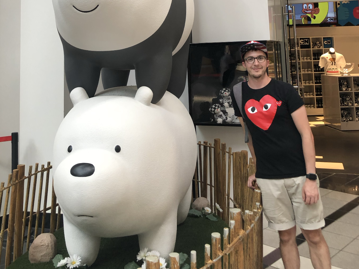 The author in the CNN Centre in Atlanta Georgia, stood next to a cartoon bear.