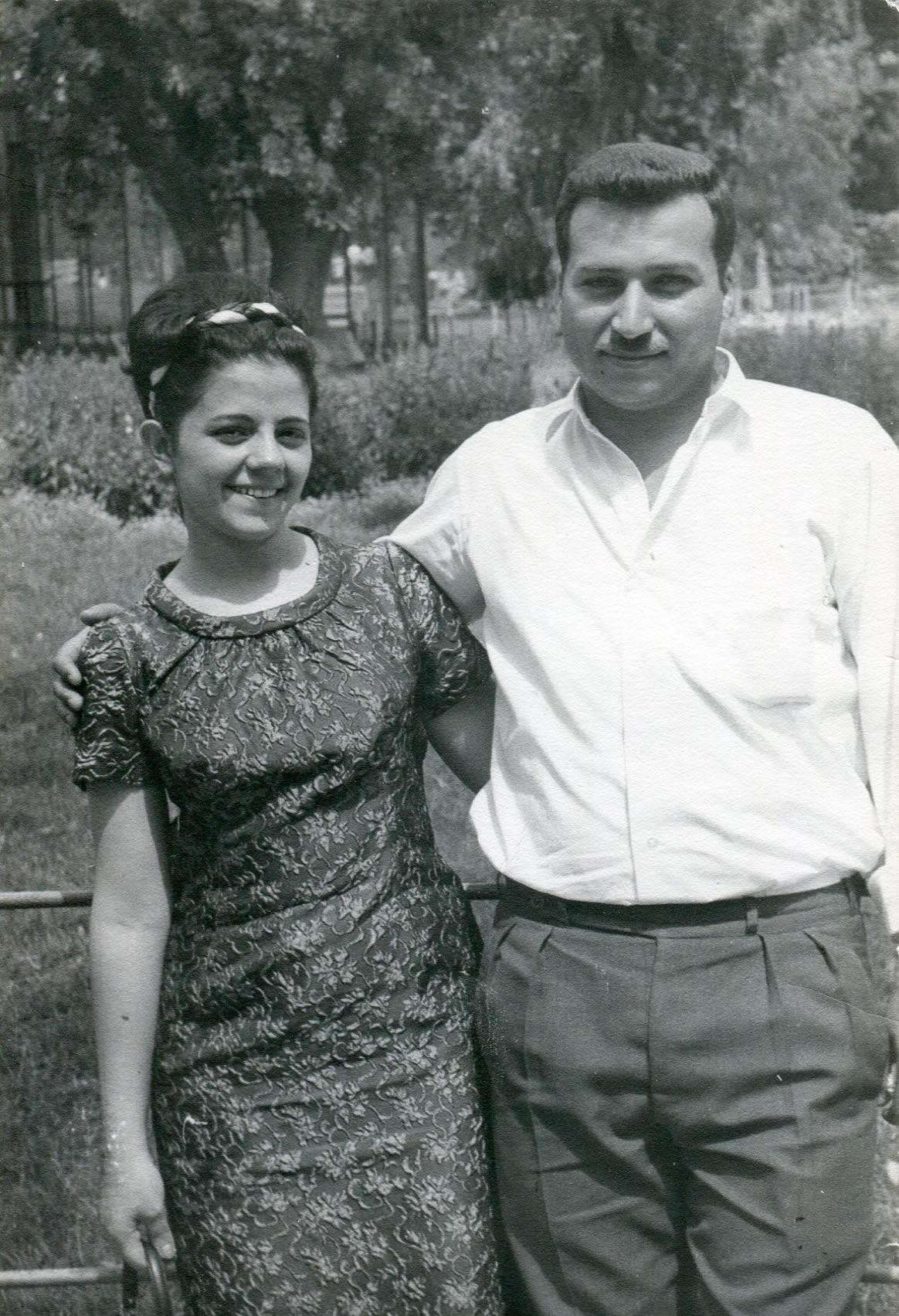 Black and white photo of my father with his arm around my mother, standing in a park in Cairo, Egypt, in the 1960s.
