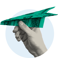 Hand launching paper airplane made out of one-dollar bill.